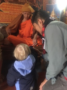 Monk giving Will a Bracelet